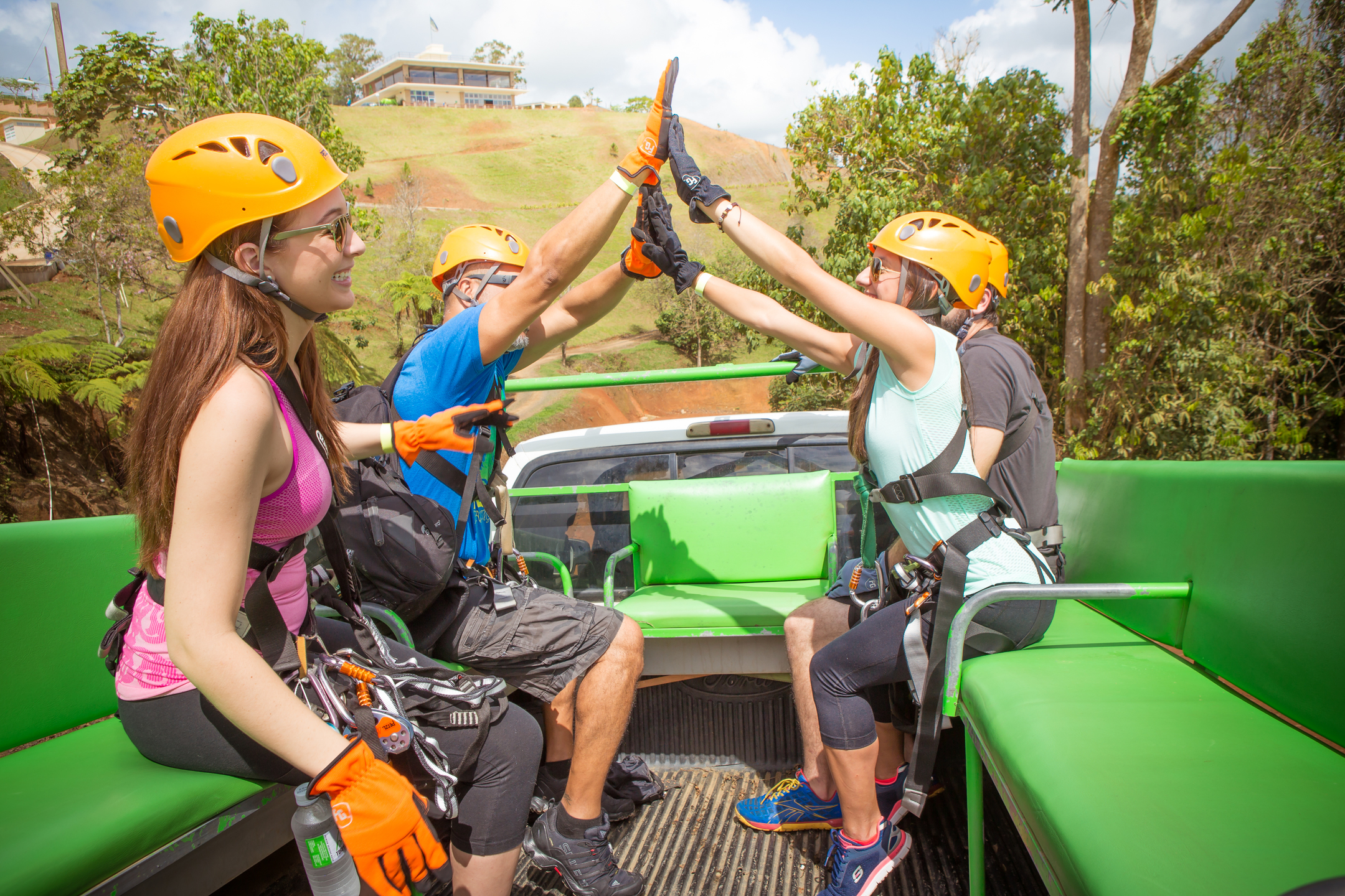 A group high-fives after an activity at Toro Verde Nature Adventure Park.