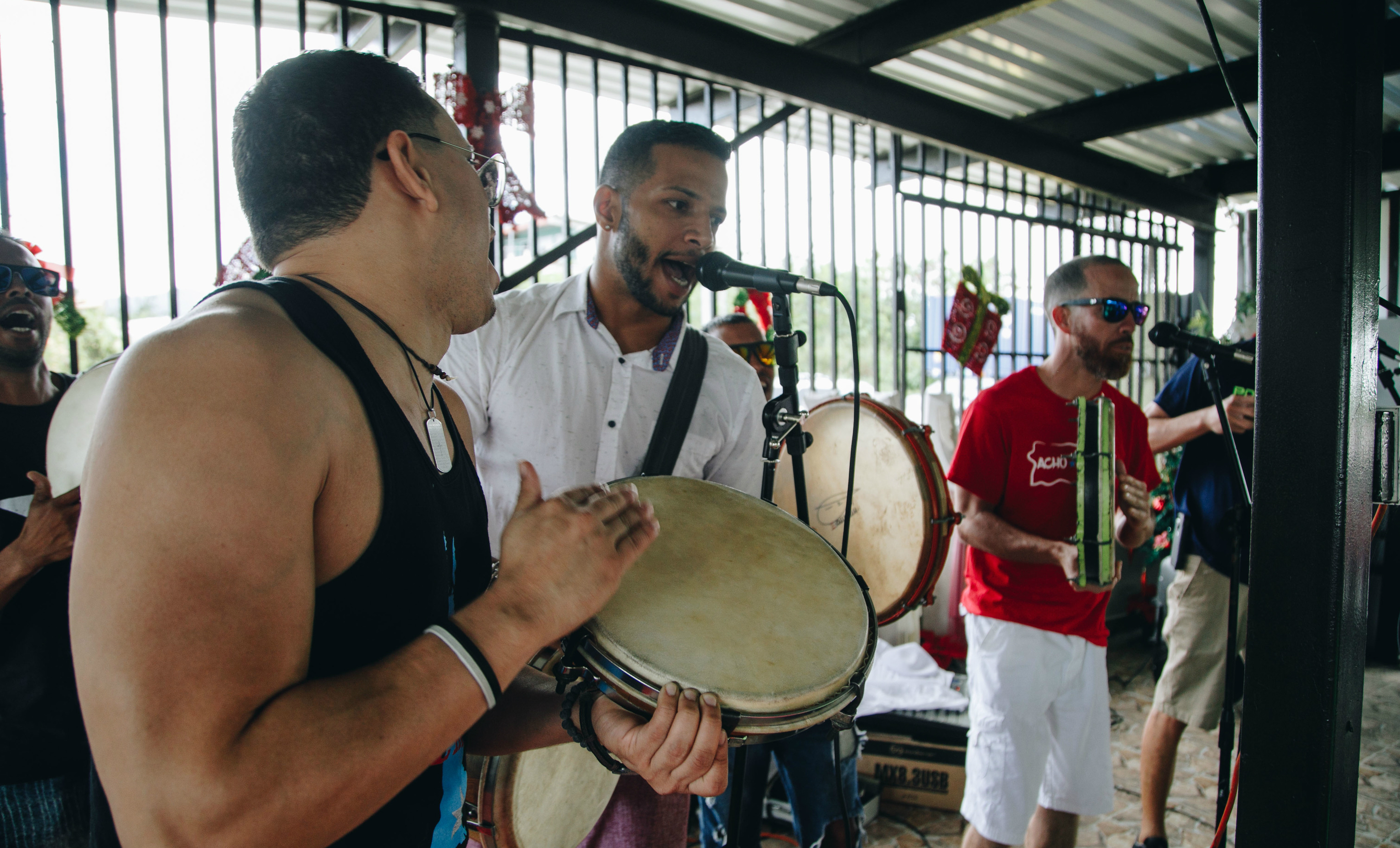 A three-person Puerto Rican band performs.