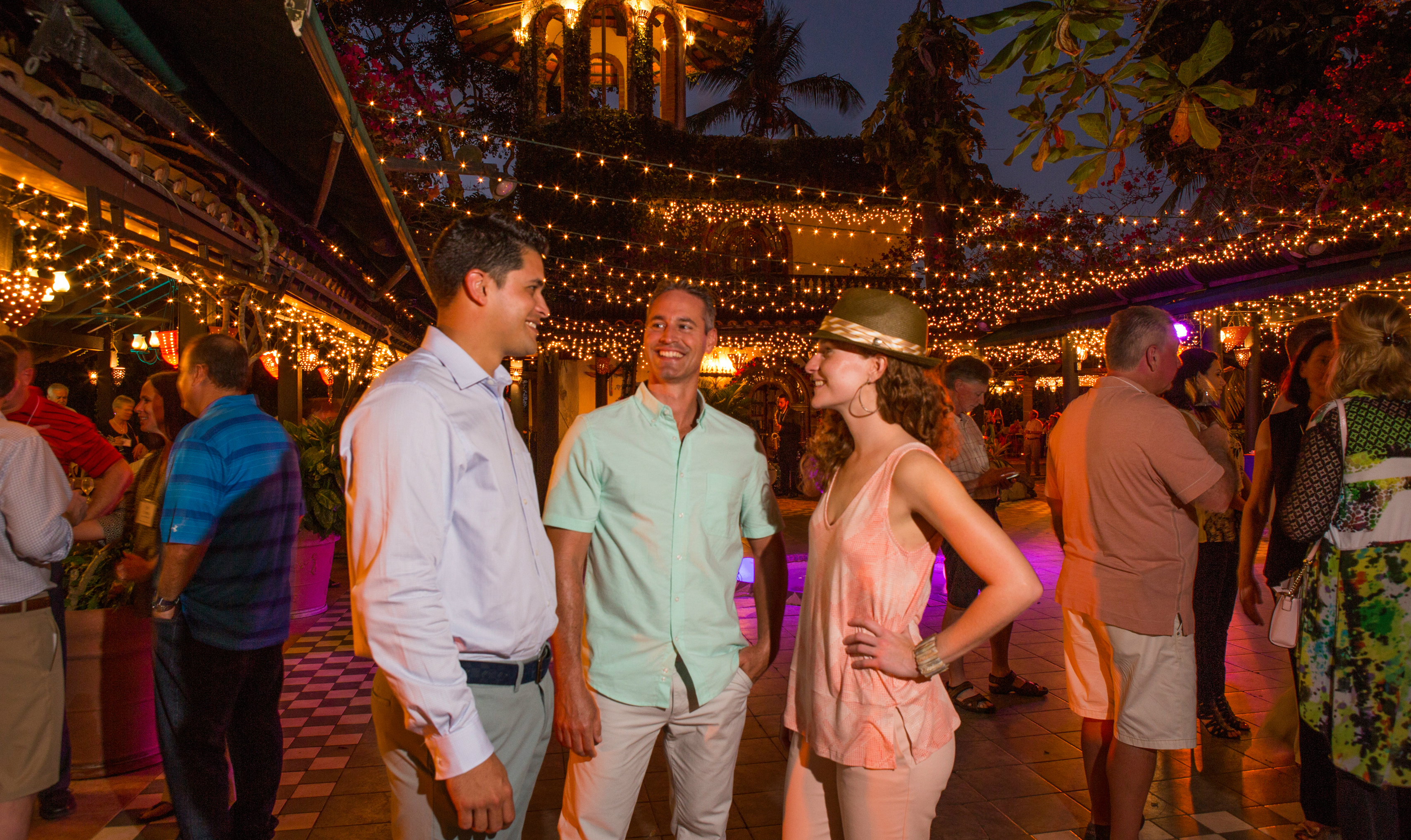 Meeting attendees mingle at a nighttime event in Puerto Rico.