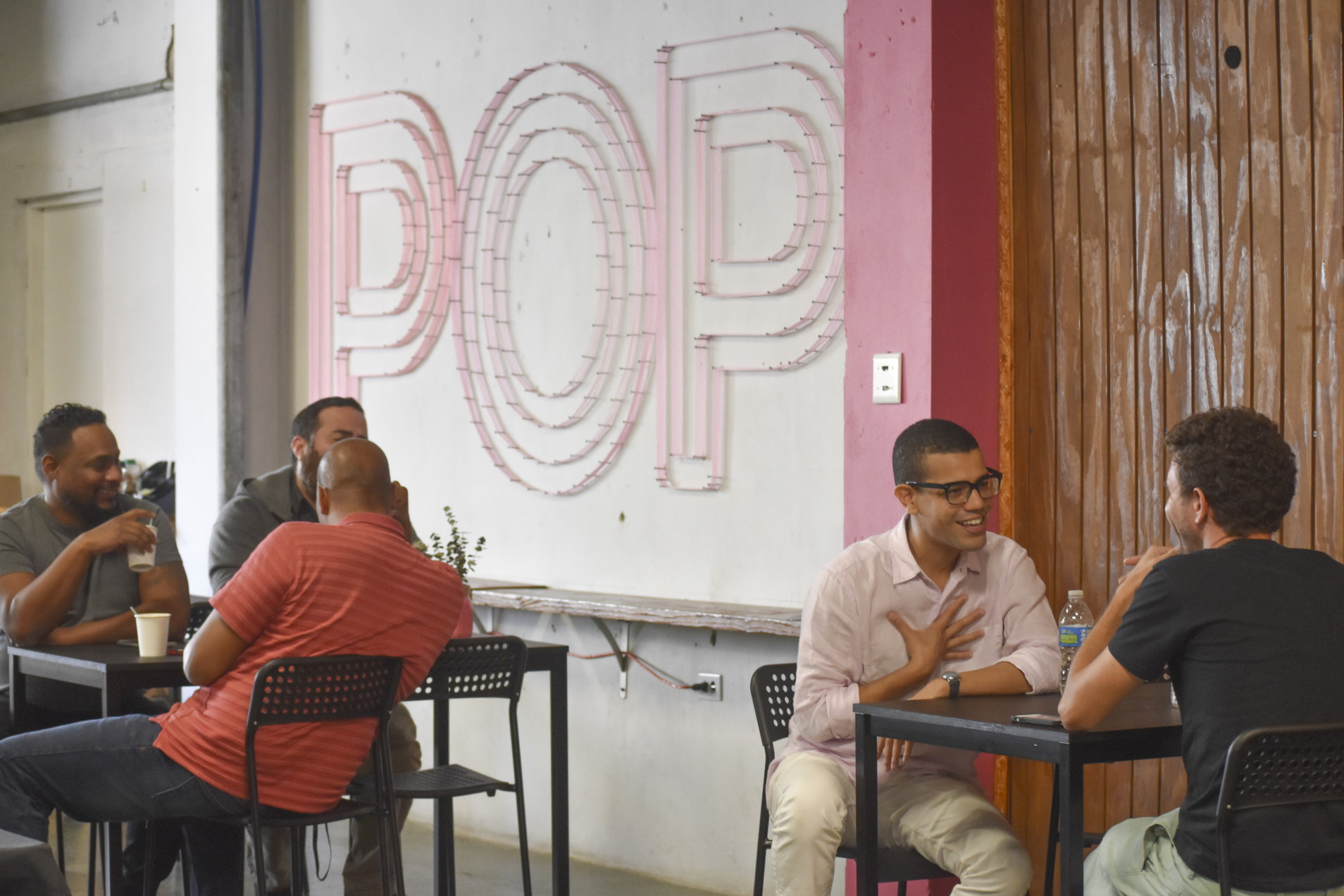 people sitting at tables and talking in POP in Santurce