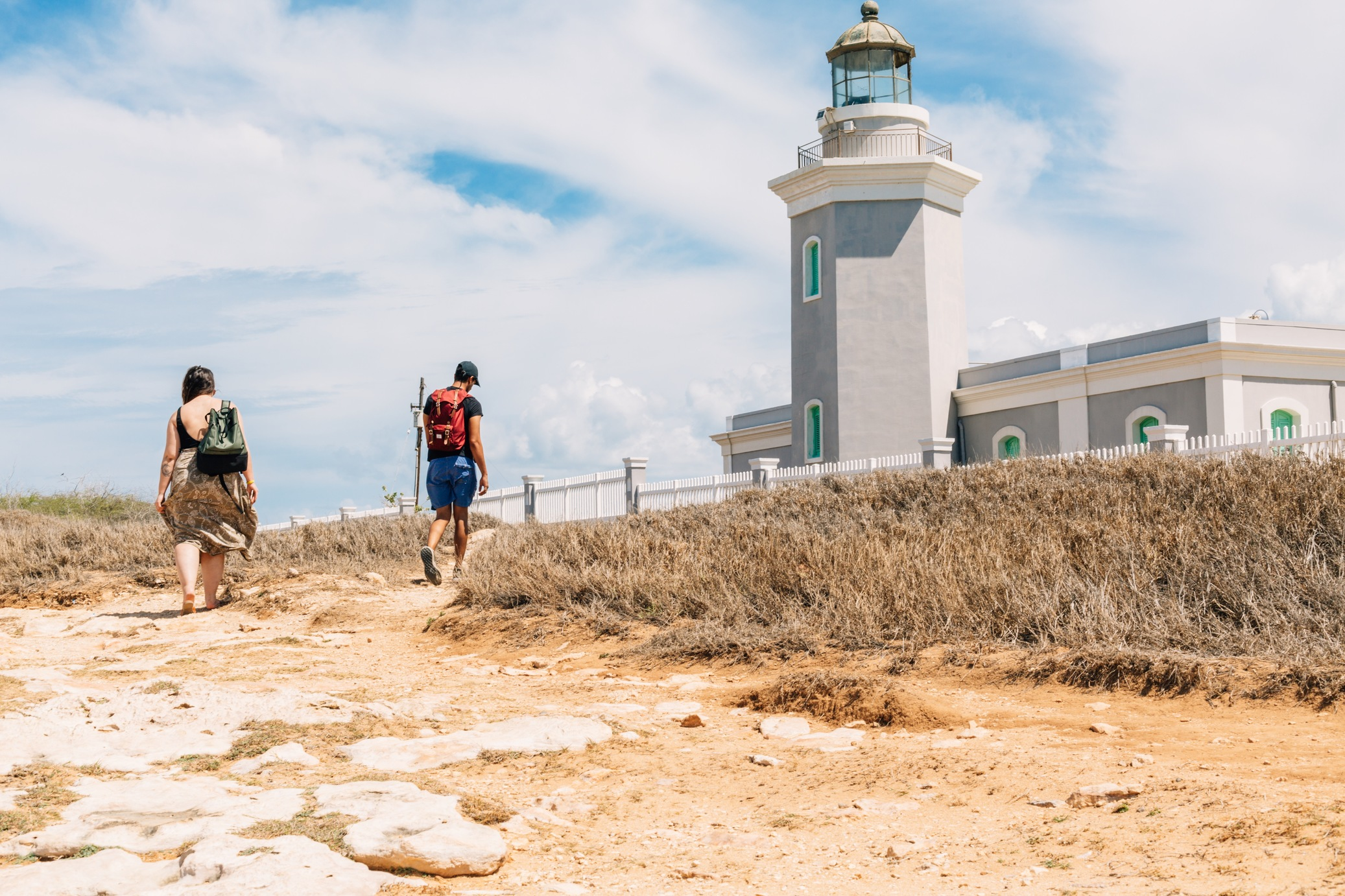Young people visiting Cabo Rojo's lighthouse.