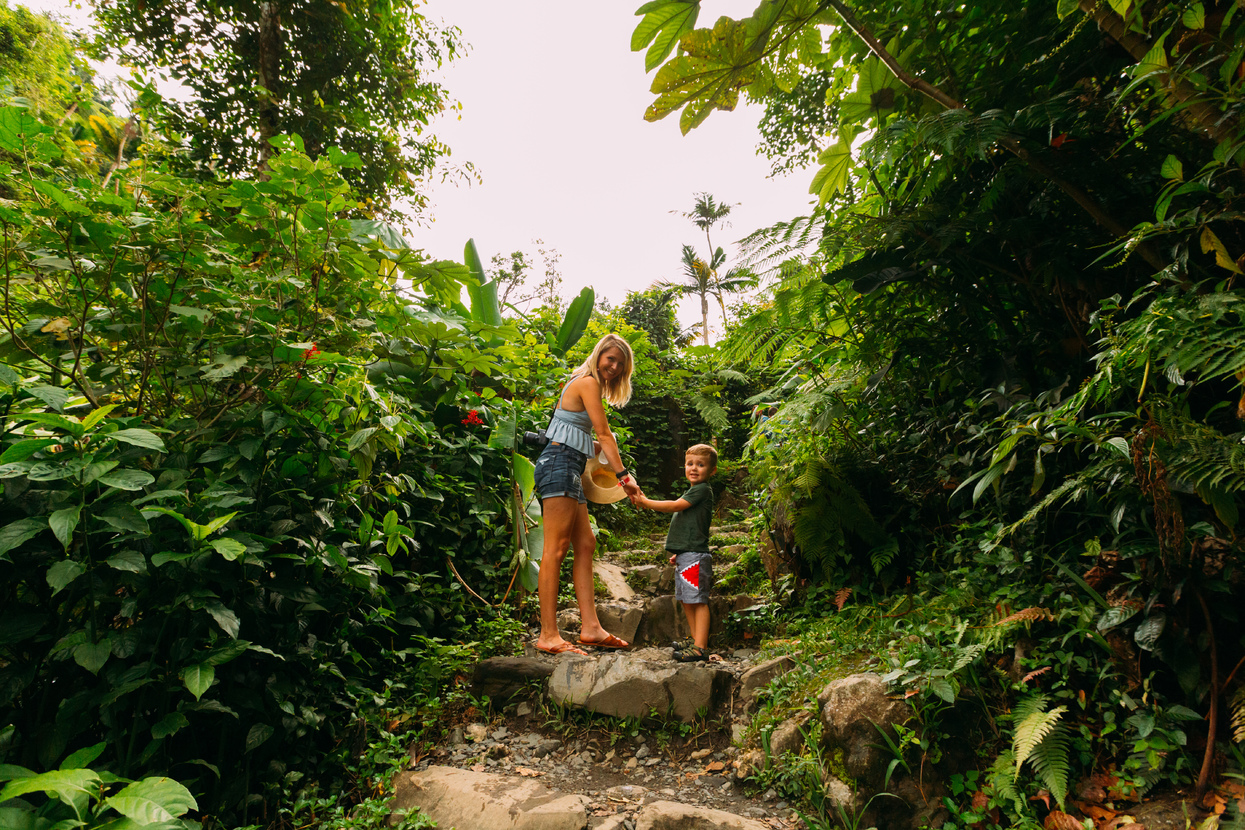 Mother and kid walking through one of El Yunque's trails.