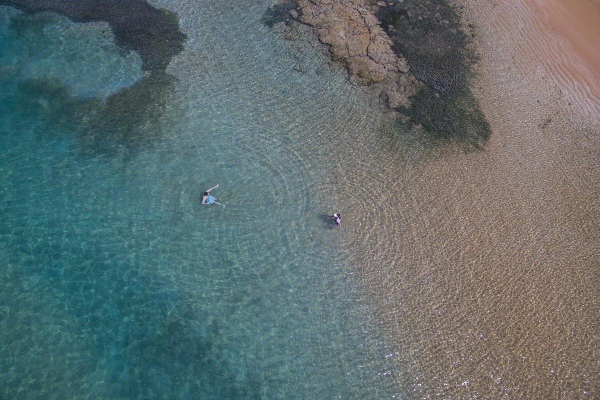Two people enjoying Fajardo's crystal-clear waters.