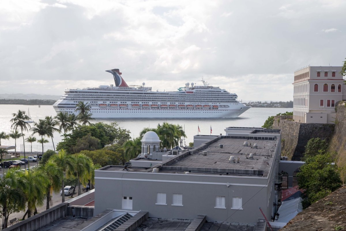 A cruise ship sails by off the coast of San Juan.