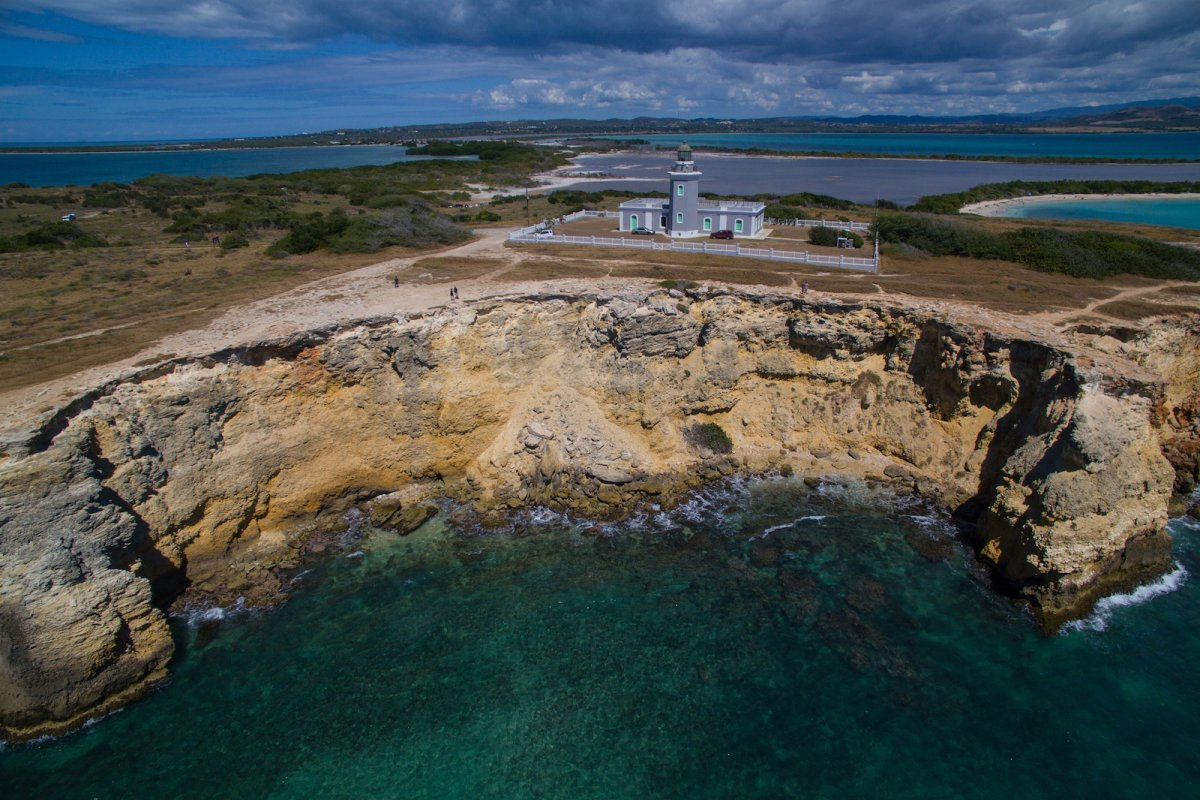 Los Morrillos Lighthouse perched on a cliff in Cabo Rojo