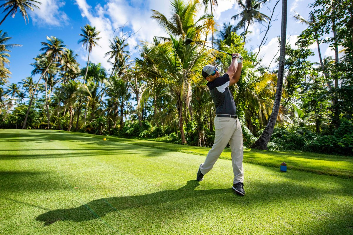 A golfer plays one of the three scenic golf courses at Dorado Beach, a Ritz-Carlton Reserve.