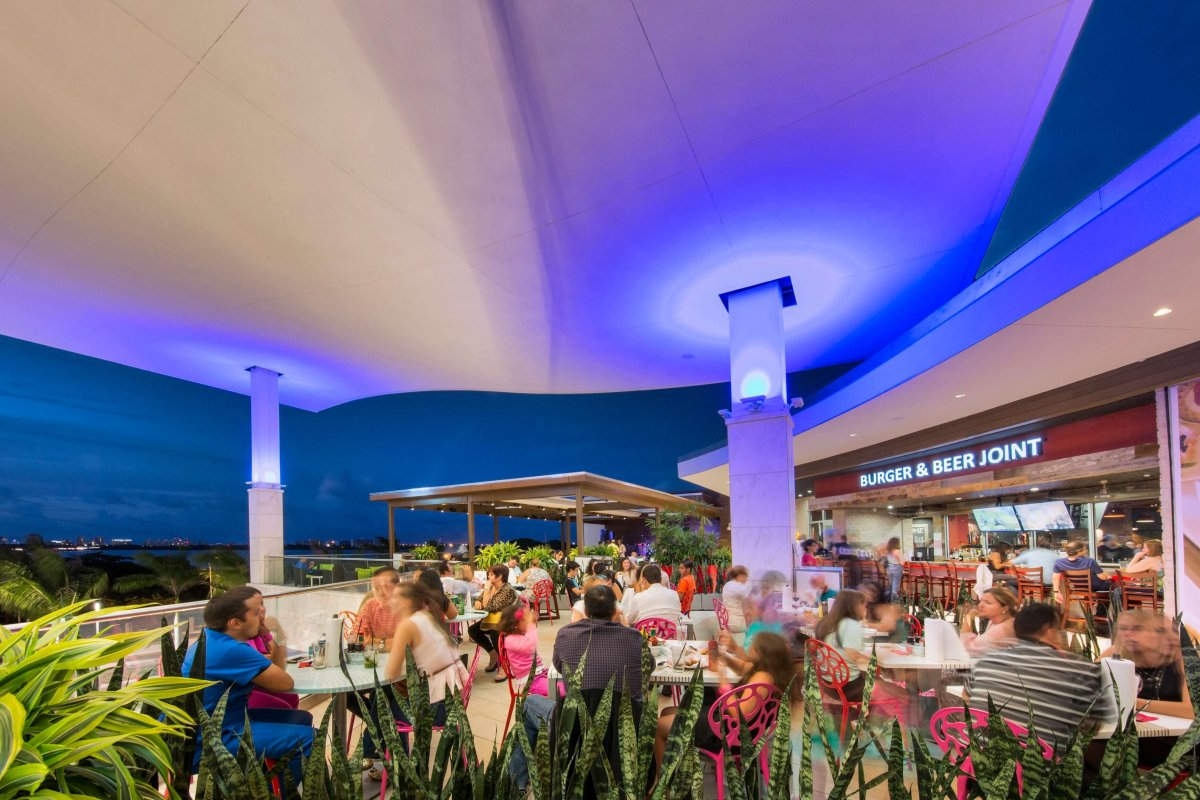 Several shoppers enjoying a relaxing evening on the terrace in the Mall of San Juan.