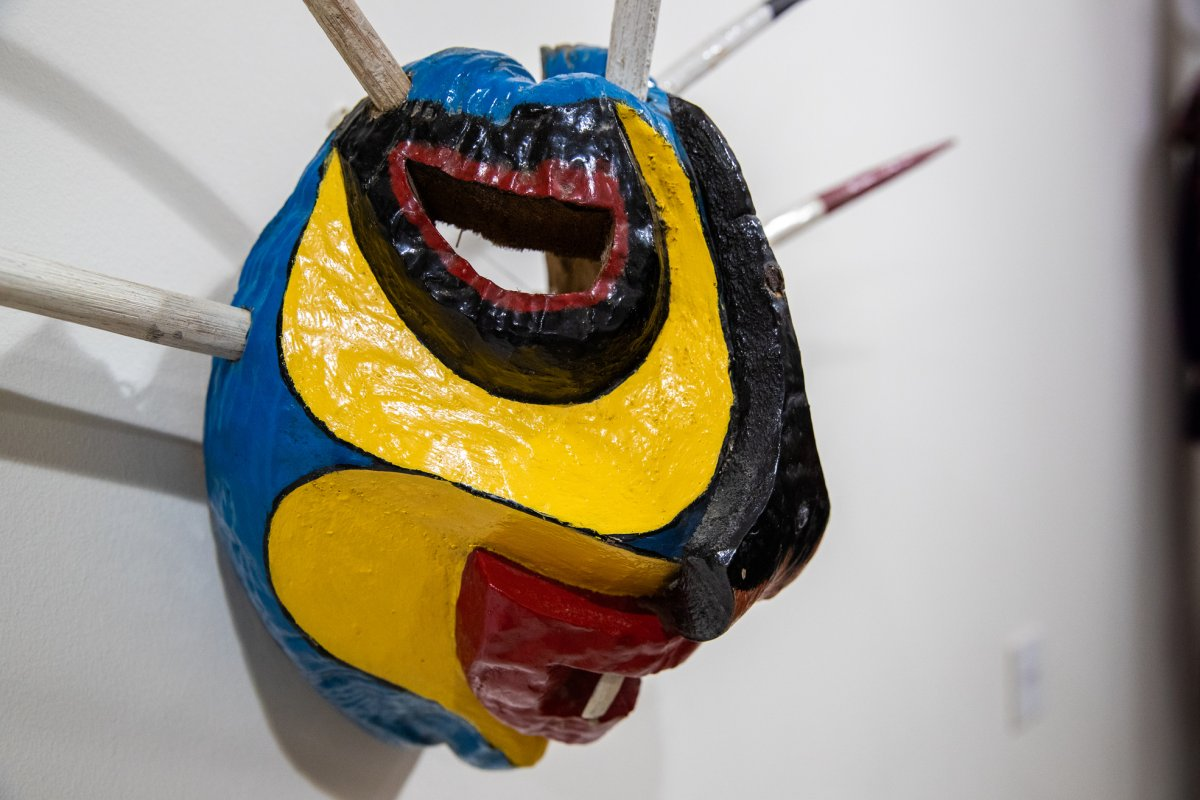 A colorful vejigante mask hangs on the wall of the museum in Loiza