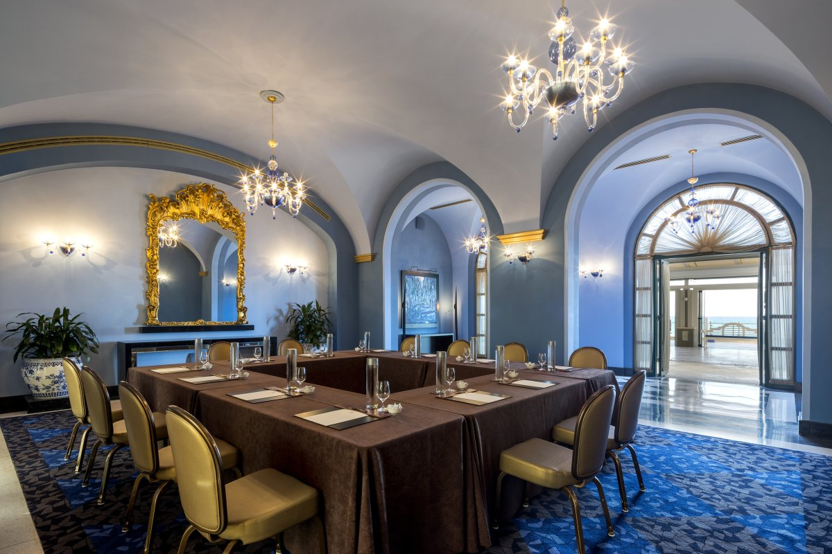 Glittering chandeliers hang in the Salon Azul meeting room at the Condado Vanderbilt Hotel.