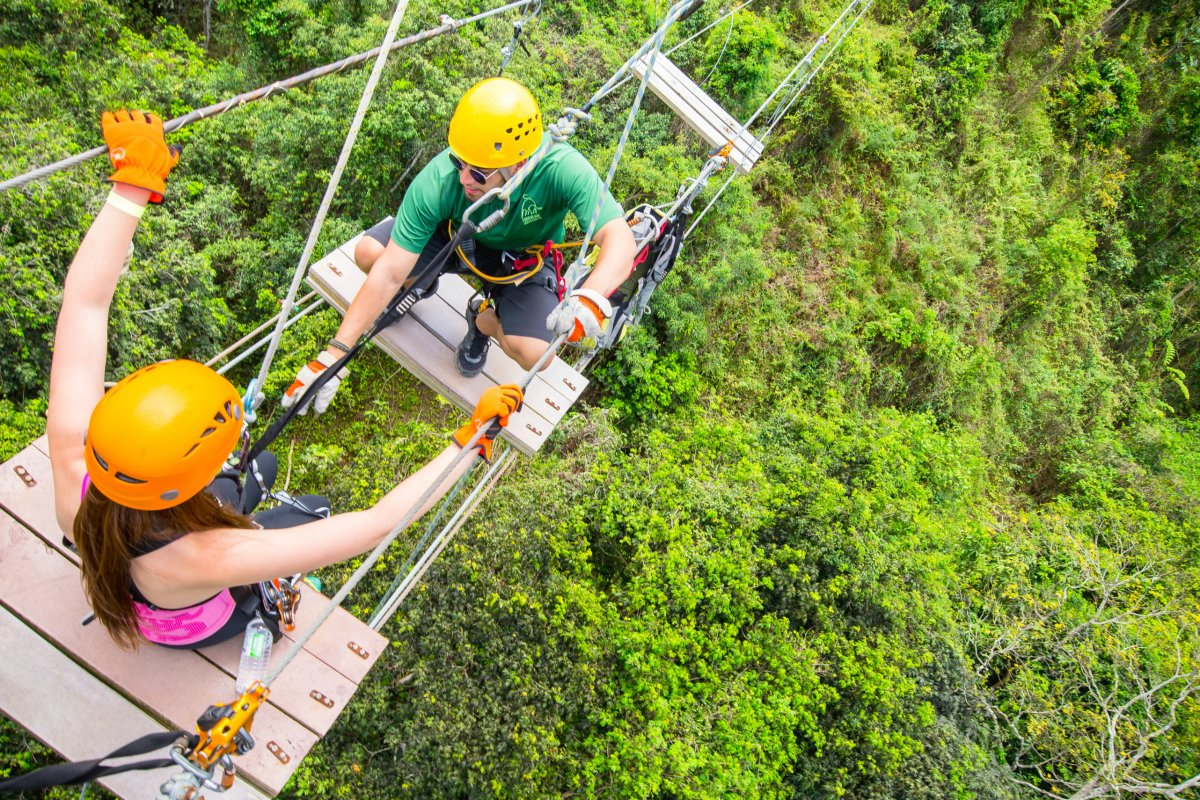 A team works together on the zipline course at Toro Verde Adventure Park.