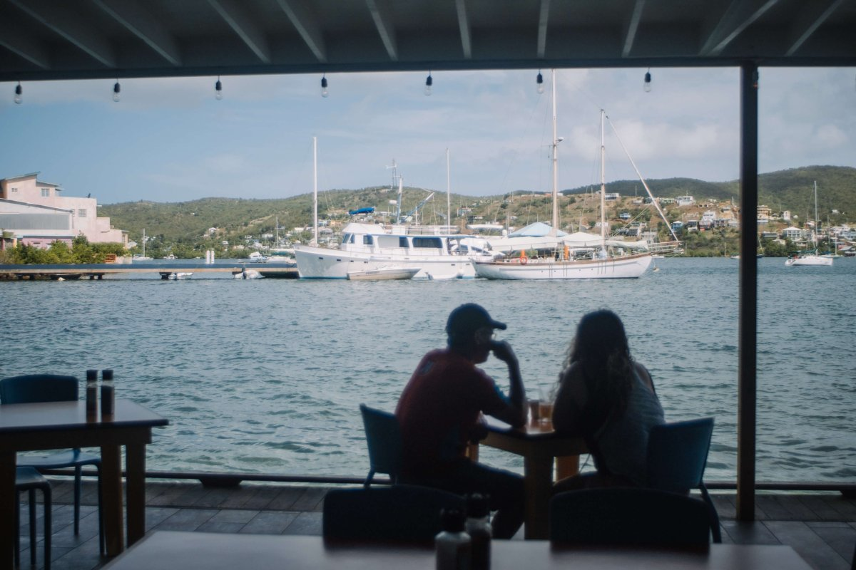 A couple dines and enjoys the views at the Dinghy Dock in Culebra.