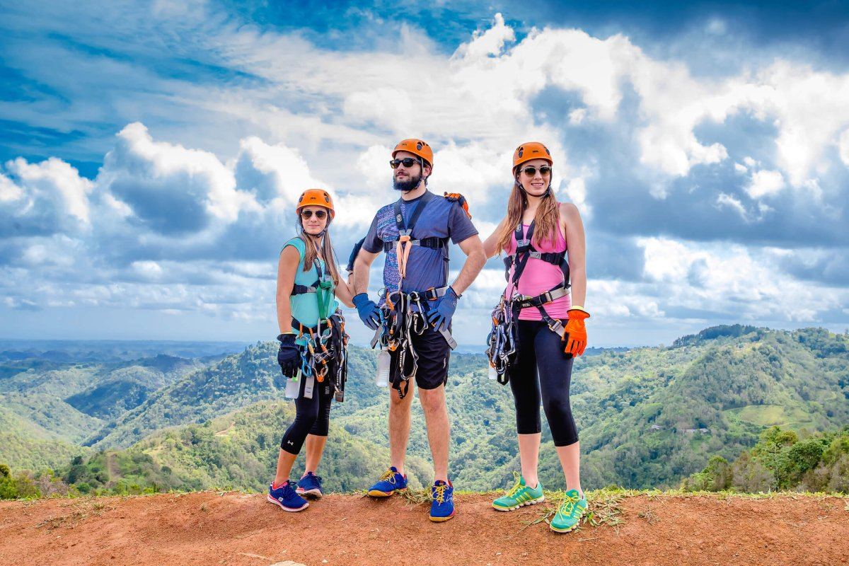 Three people admire the views at Toro Verde Adventure Park.