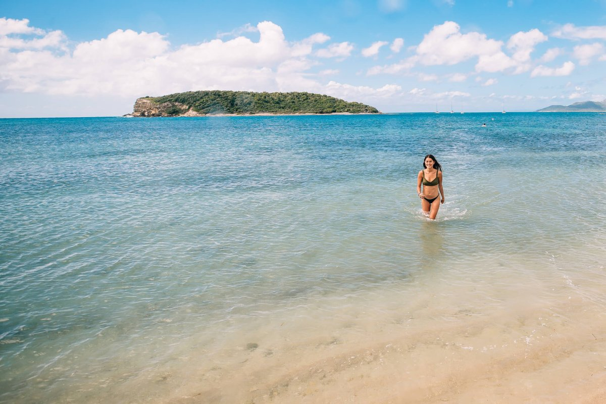 Woman enjoying the clear waters at La Esperanza Beach in Vieques.