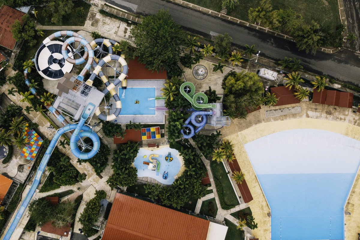 An aerial view of the water slides and wave pool of Olimpia Water Park at Albergue Olimpico.