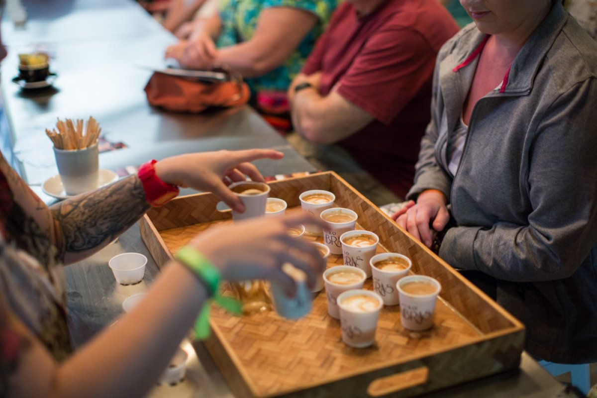 A group samples Puerto Rican coffee on a Flavors of San Juan food tour.