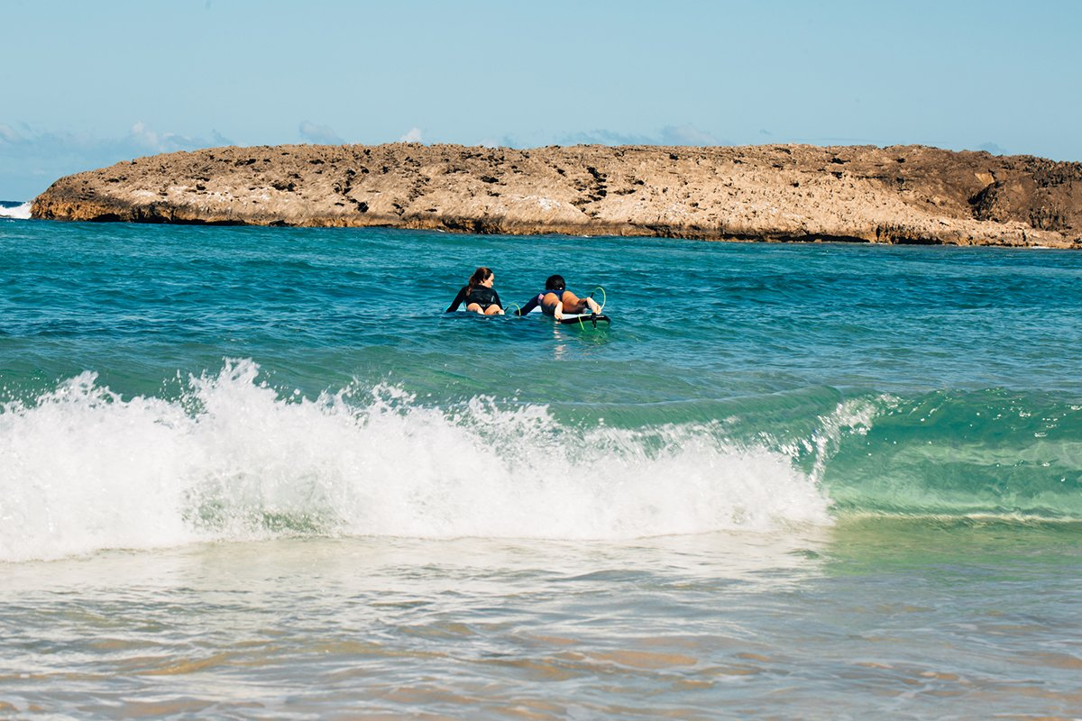 Two surfers enjoy Jobos Beach in Isabela.