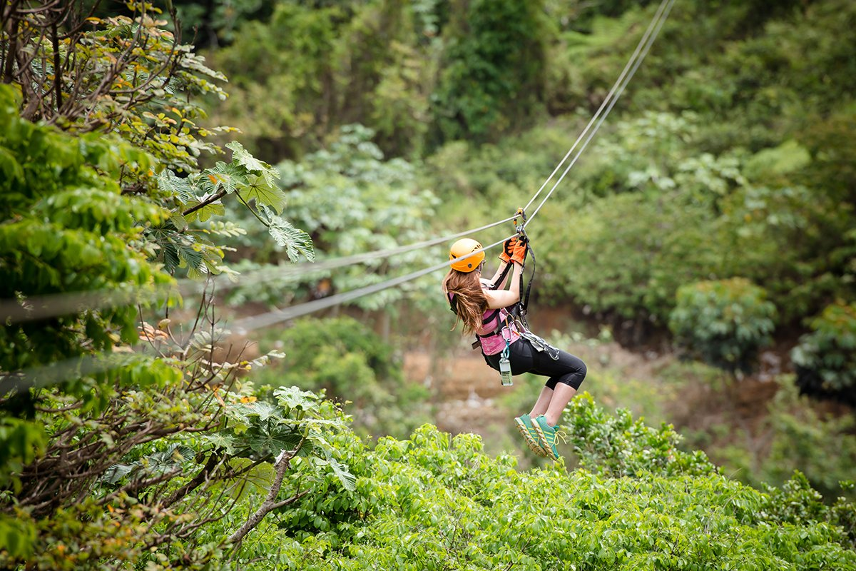 Woman ziplines down a rail at Toro Verde in Orocovis