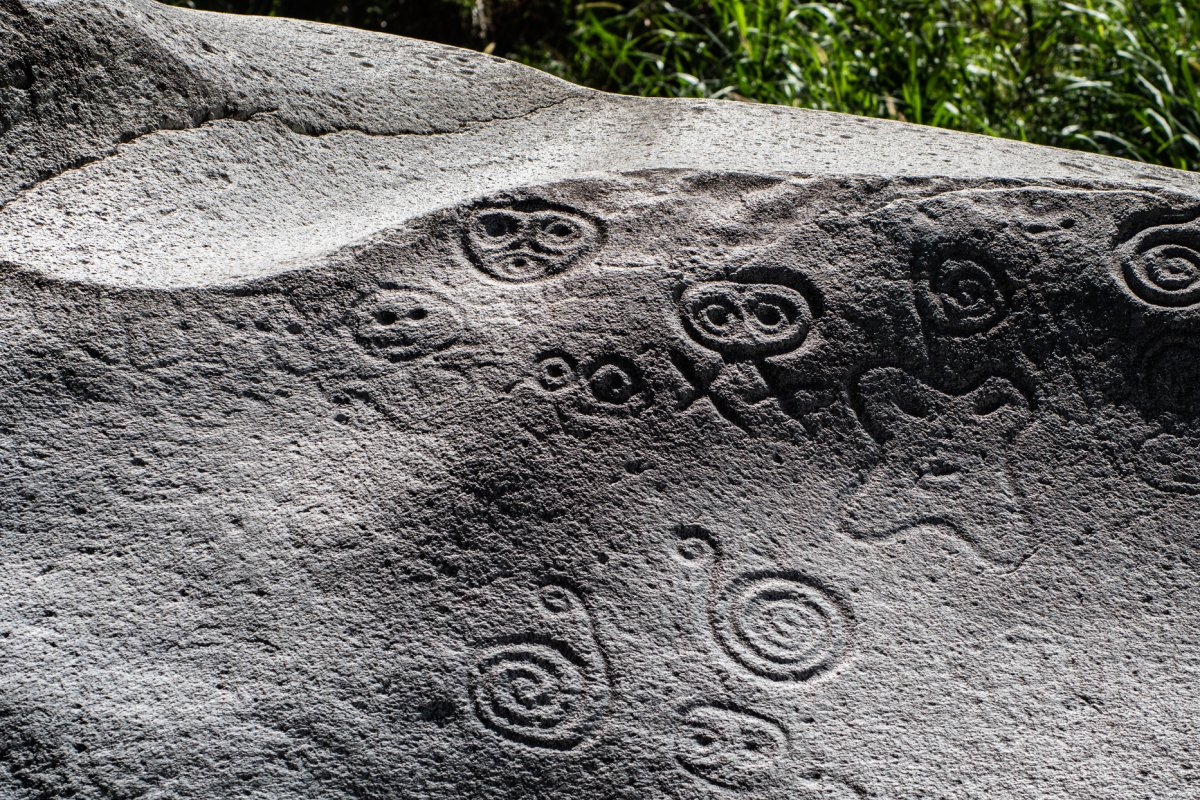 Ancient petroglyphs carved into a rock in Jayuya, Puerto Rico