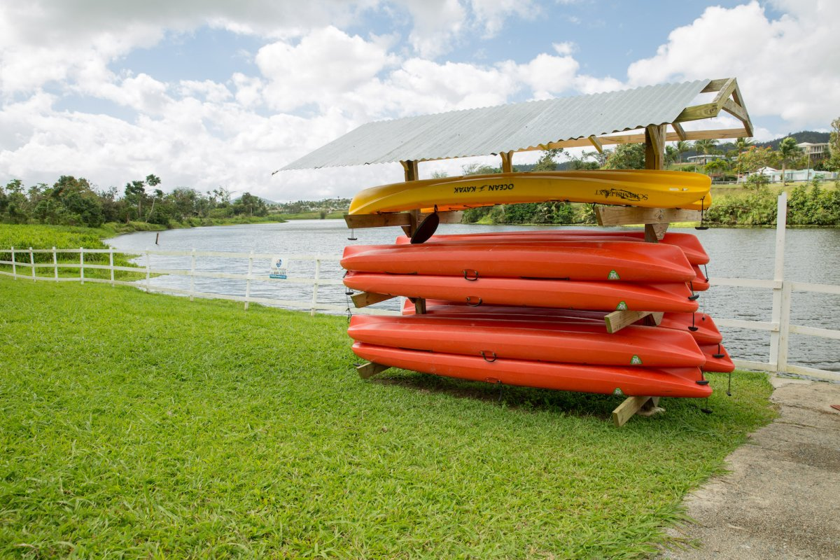 Kayaks line the shore at Paradise Paddle PR