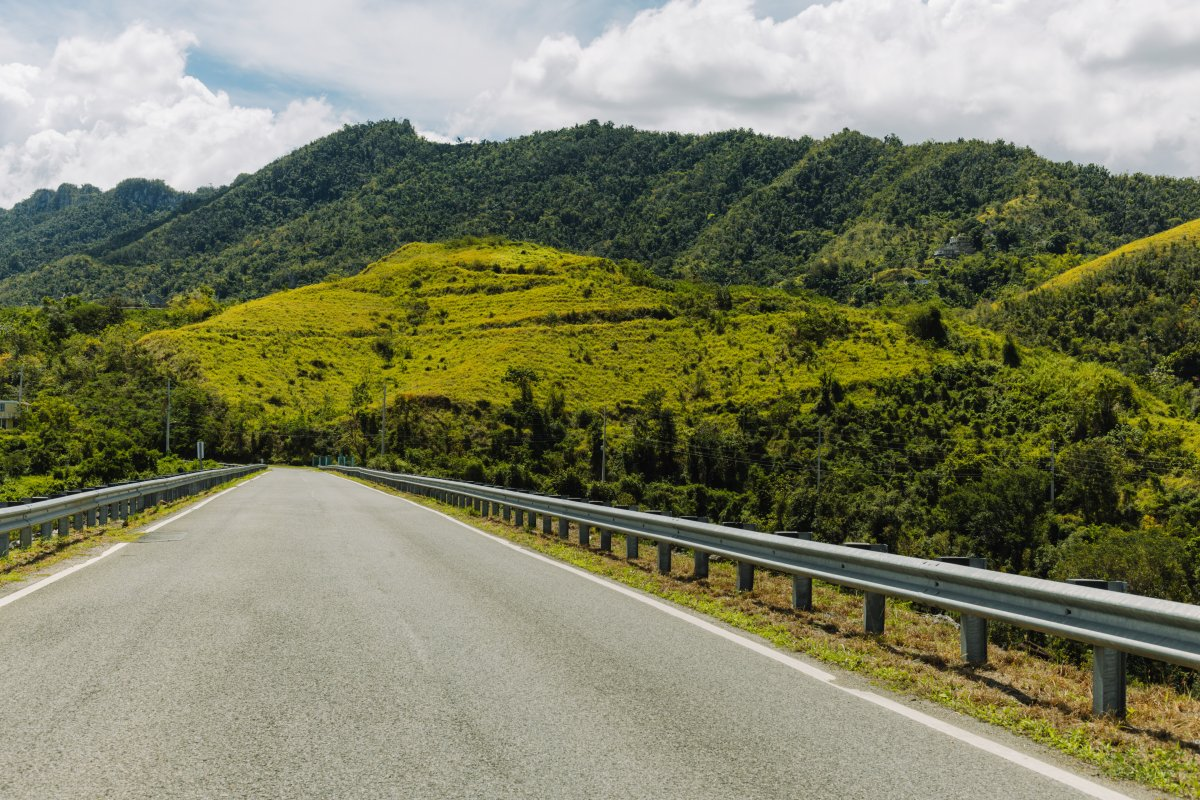 A wide view of a road through Puerto Rico's Mountains.