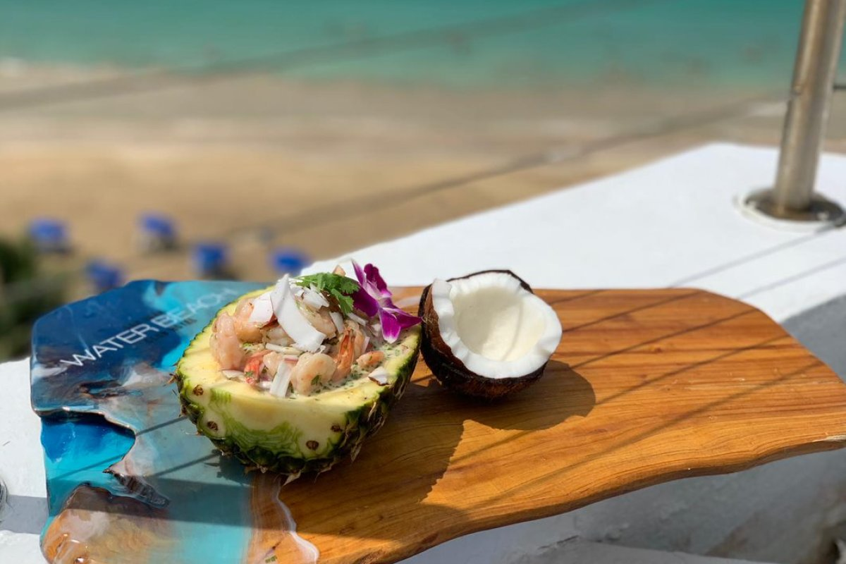 Shrimp ceviche is served in a pineapple at the SJ Water and Beach Club Hotel