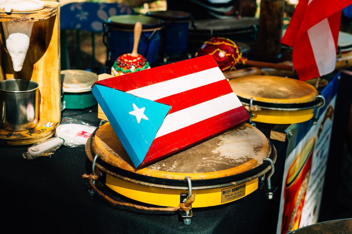Puerto Rican flag and instruments.