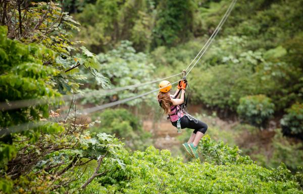 A woman flies down a zipline at Toro Verde Adventure Park.