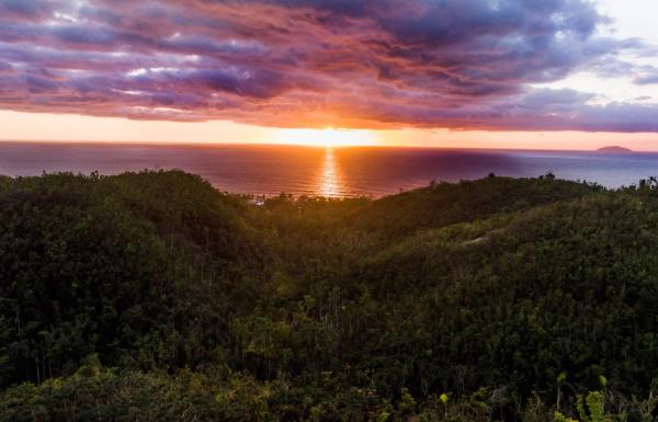 A dramatic sunset over the ocean from puntas rincon in western puerto rico