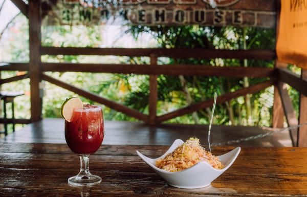 A glass of sangria and creole cuisine at ASAO smokehouse in Ciales