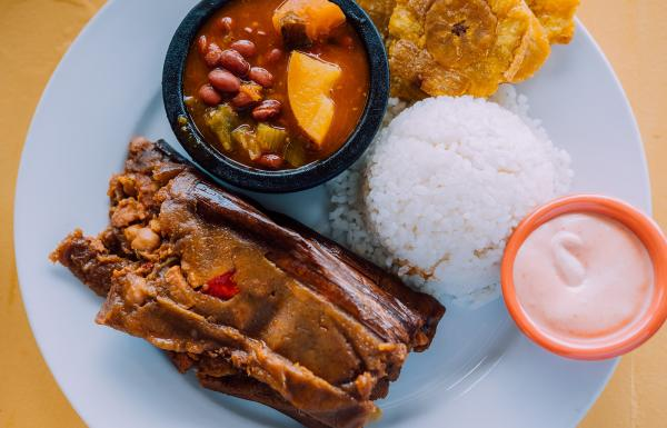 Traditional rice and beans plate with tostones.
