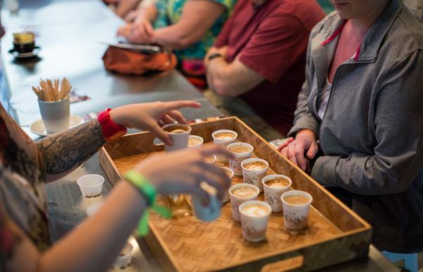 A group samples local coffee in Puerto Rico.