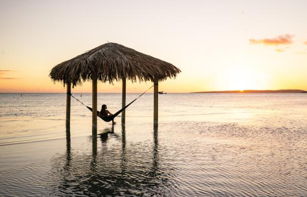 A woman relaxes in an overwater hammock at Copamarina Resort in Guánica.