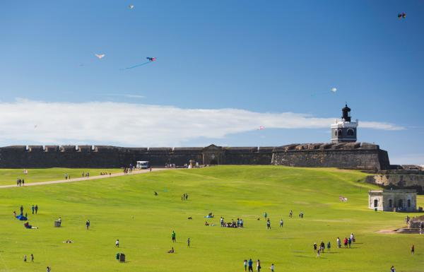 Visitors fly kites on the grounds of El Morro in Old San Juan.