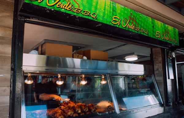 Glass display of El Verde's roasted chiken