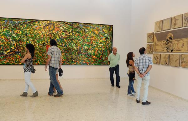 People view an art exhibit at the Museo de Arte de Bayamon.