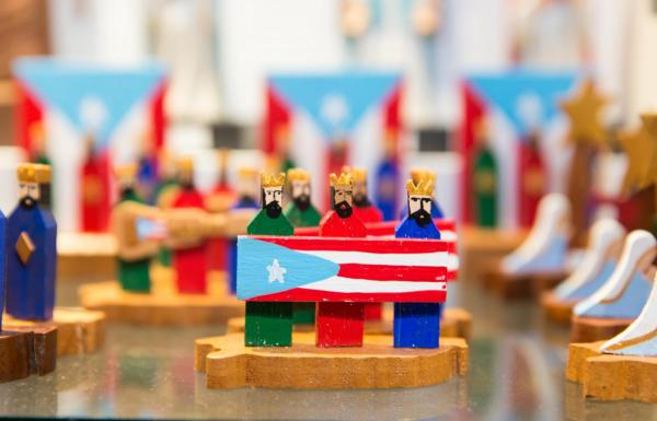 Three Kings of Puerto Rico holding the Puerto Rican flag.