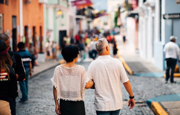 A couple enjoys a stroll through the cobblestone streets of Old San Juan.