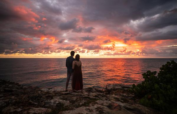 A couple watches the sunset at Cabo Rojo