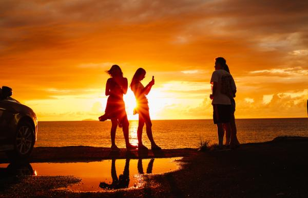Friends enjoy a beautiful sunset in Aguadilla