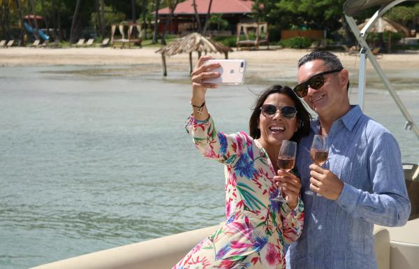 Couple taking a selfie in front of the beach in Copamarina Resort in Guanica