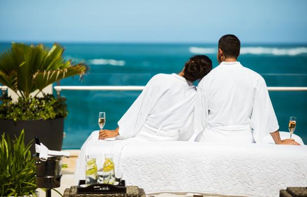 A couple watching the ocean from the Condado Vanderbilt hotel.