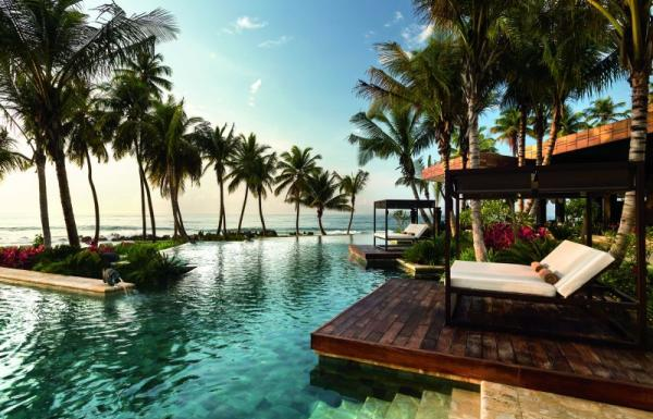 Relax by the pool at the Ritz Carlton Reserve