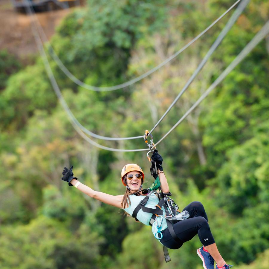 Woman zipping down the Toro Verde Zipline