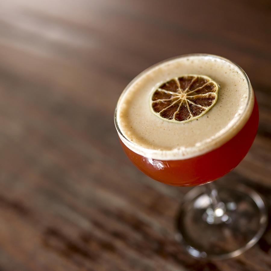 An expertly crafted cocktail from La Factoria.