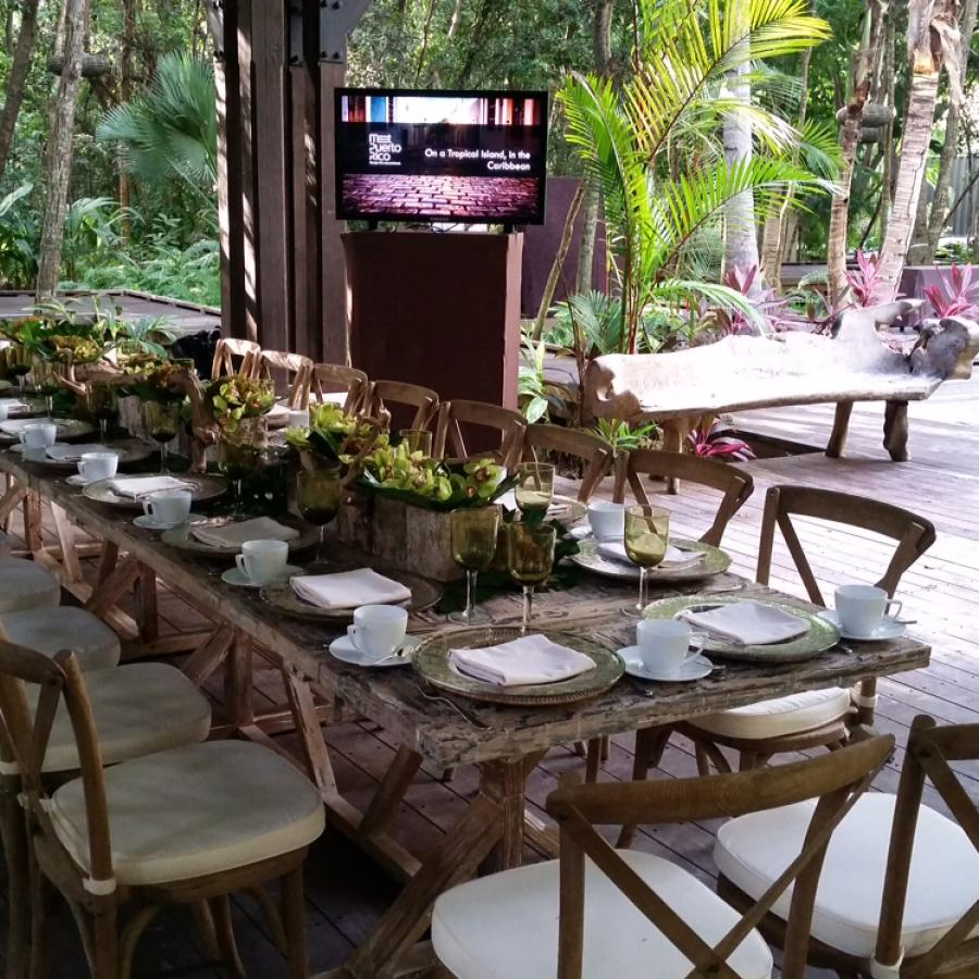 An outdoor table is set for guests at the St. Regis Bahia Beach Resort.