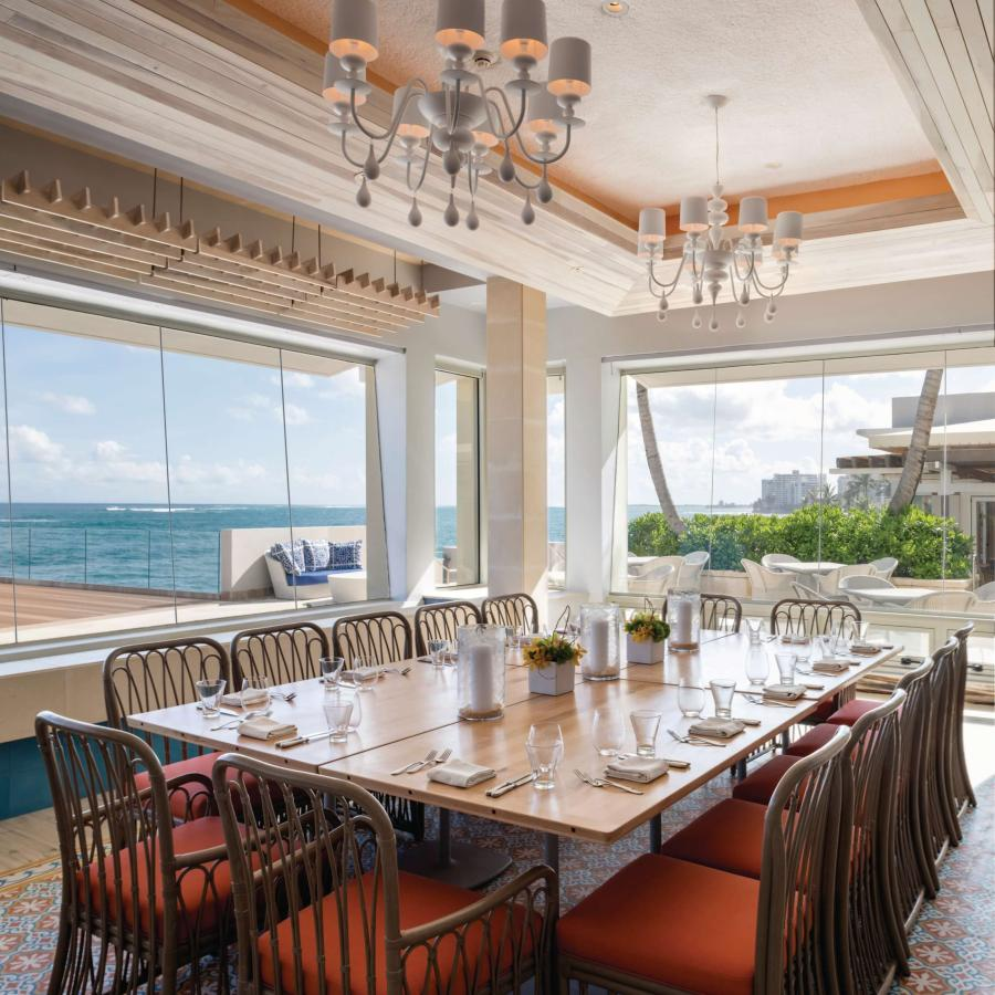 A private dining room with ocean views at Restaurant Ola in the Condado Vanderbilt Hotel.