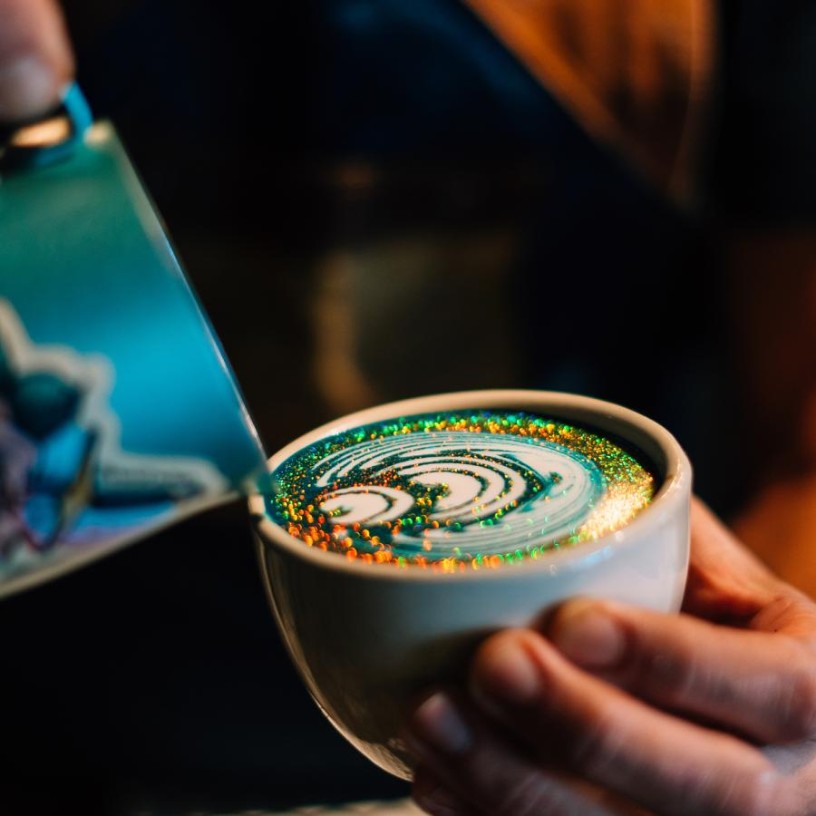 A barista prepares an elaborately decorated coffee drink at Bistro Cafe in Carolina.