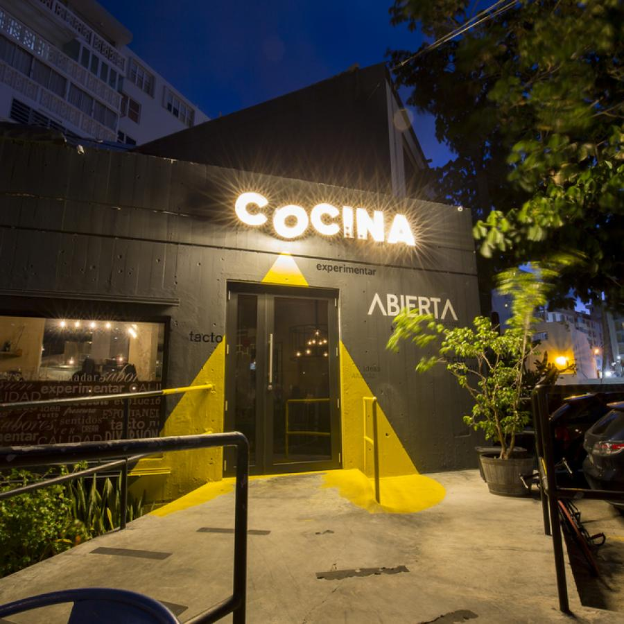 The exterior of Cocina Abierta restaurant in San Juan at night.