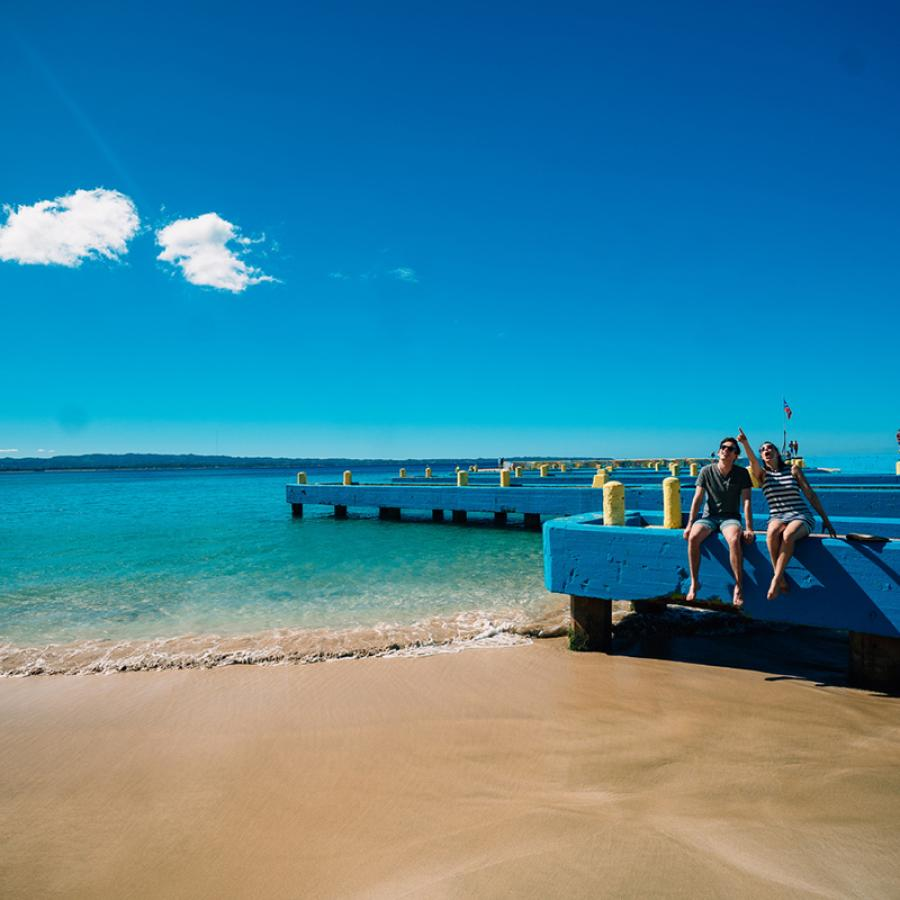 Two people enjoying Crashboat Beach in Aguadilla.
