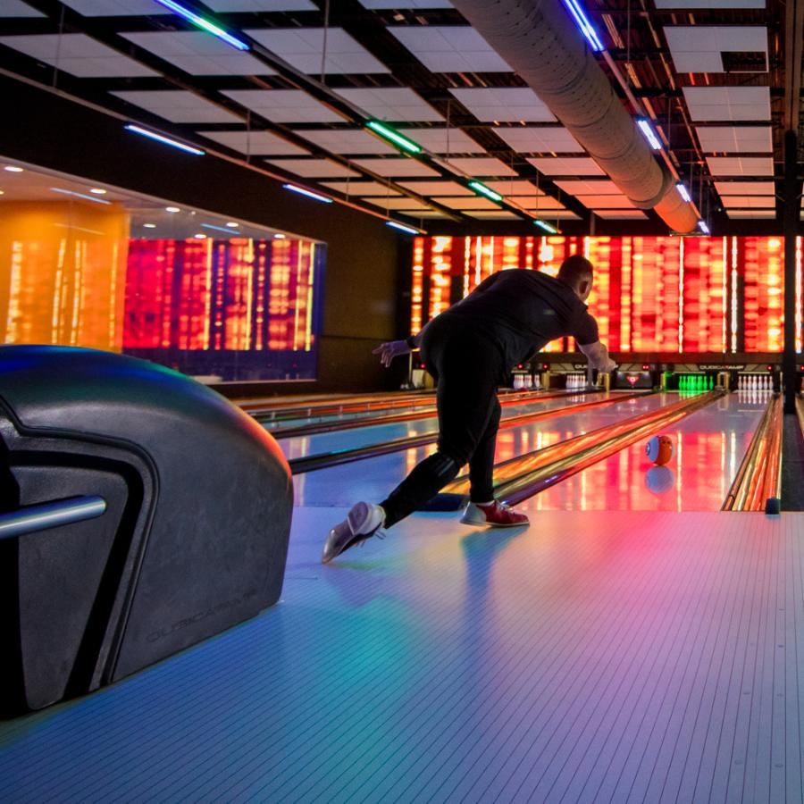 A person bowls at the Route 66 Mall bowling alley.